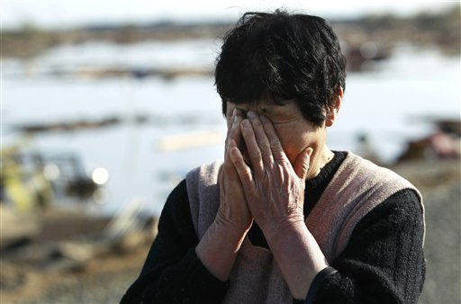 "<div class=""meta image-caption""><div class=""origin-logo origin-image ""><span></span></div><span class=""caption-text"">A resident wipes tears as she finds no remains of her home, Monday, March 14, 2011, in Soma city, Fukushima prefecture, Japan, three days after a massive earthquake and tsunami struck the country's north east coast. (AP Photo/Wally Santana) (Photo/Wally Santana)</span></div>"