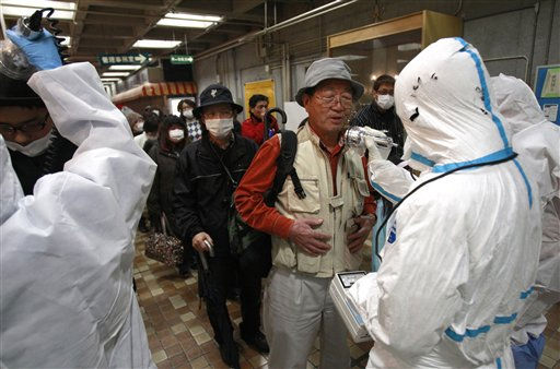 "<div class=""meta image-caption""><div class=""origin-logo origin-image ""><span></span></div><span class=""caption-text"">An evacuee is screened for radiation exposure at a testing center Tuesday, March 15, 2011, in Koriyama city, Fukushima prefecture, Japan, after a nuclear power plant on the coast of the prefecture was damaged by Friday's earthquake. (AP Photo/Wally Santana) (AP Photo/ Wally Santana)</span></div>"