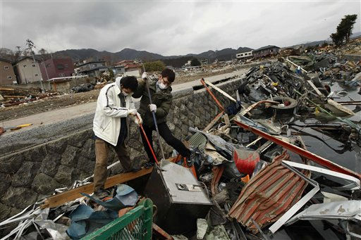Local men try to break open a safe they said washed away from their restaurant in Ofunato, Japan, Tuesday, March 15, 2011. Two search and rescue teams from the U.S. and a team from the U.K. with combined numbers of around 220 personnel, searched damaged areas of the town of Ofunato for trapped survivors Tuesday in the aftermath of the earthquake and tsunami. &#40;AP Photo&#47;Matt Dunham&#41; <span class=meta>(AP Photo&#47; Matt Dunham)</span>