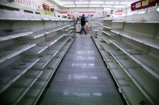 A man shops in a convenience store where shelves on food aisles are left empty in Ofunato, Iwate Prefecture, northern Japan, Tuesday, March 15, 2011, four days after a powerful earthquake-triggered tsunami hit Japan&#39;s east coast. &#40;AP Photo&#47;Shizuo Kambayashi&#41; <span class=meta>(AP Photo&#47; Shizuo Kambayashi)</span>