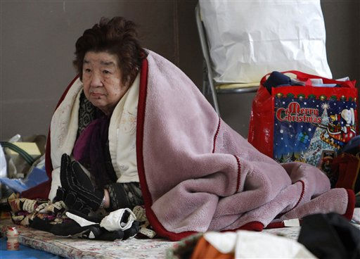 "<div class=""meta image-caption""><div class=""origin-logo origin-image ""><span></span></div><span class=""caption-text"">A woman wears layers of blankets and gloves to stay warm at a makeshift shelter at Ofunato, Iwate Prefecture, northern Japan, Tuesday, March 15, 2011, four days after a powerful earthquake-triggered tsunami hit Japan's east coast. (AP Photo/Shizuo Kambayashi) (AP Photo/ Shizuo Kambayashi)</span></div>"