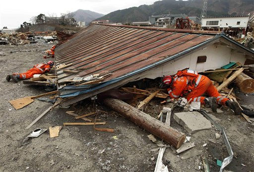 "<div class=""meta image-caption""><div class=""origin-logo origin-image ""><span></span></div><span class=""caption-text"">British search and rescue workers search under a roof removed from a house for survivors of the tsunami in Ofunato, Japan, Tuesday, March 15, 2011.  Two search and rescue teams from the U.S. and a team from the U.K. with combined numbers of around 220 personnel, searched damaged areas of the town of Ofunato for trapped survivors Tuesday in the aftermath of the earthquake and tsunami. (AP Photo/Matt Dunham) (AP Photo/ Matt Dunham)</span></div>"