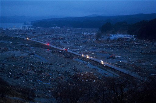 "<div class=""meta image-caption""><div class=""origin-logo origin-image ""><span></span></div><span class=""caption-text"">Japanese vehicles pass through the ruins of the leveled city of Minamisanriku, northeastern Japan, Tuesday March 15, 2011. (AP Photo/David Guttenfelder) (AP Photo/ David Guttenfelder)</span></div>"