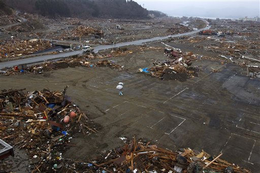 "<div class=""meta image-caption""><div class=""origin-logo origin-image ""><span></span></div><span class=""caption-text"">Japanese survivors of Friday's earthquake and tsunami walk under umbrellas through the leveled city of Minamisanriku, in northeastern Japan, Tuesday, March 15, 2011. (AP Photo/David Guttenfelder) (AP Photo/ David Guttenfelder)</span></div>"