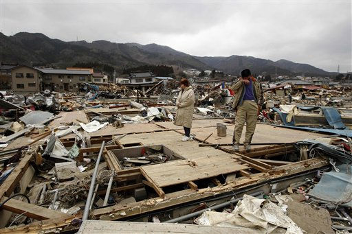 "<div class=""meta image-caption""><div class=""origin-logo origin-image ""><span></span></div><span class=""caption-text"">Keijo Nakamura, right, and his wife Haruka react as they stand on the remains of a dead relative's home after the house was washed away by the tsunami in Ofunato, Japan, Tuesday, March 15, 2011.  Two search and rescue teams from the U.S. and a team from the U.K. with combined numbers of around 220 personnel, searched damaged areas of the town of Ofunato for trapped survivors Tuesday in the aftermath of the earthquake and tsunami. (AP Photo/Matt Dunham) (AP Photo/ Matt Dunham)</span></div>"