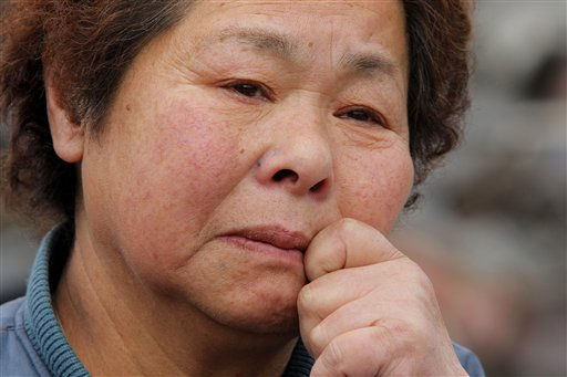 Reiko Miura, 68, cries as she looks for her sister&#39;s son at a tsunami-hit area in Otsuchi, Iwate Prefecture, northern Japan, Wednesday, March 16, 2011, after Friday&#39;s earthquake and tsunami. &#40;AP Photo&#47;Itsuo Inouye&#41; <span class=meta>(Photo&#47;Itsuo Inouye)</span>