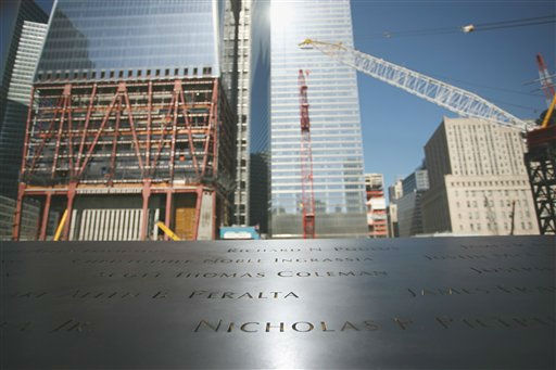"<div class=""meta ""><span class=""caption-text "">This March 2011 photo provided by the National September 11 Memorial & Museum shows a detail of the monument at New York's World Trade Center site bearing the names of those who perished there in the Sep. 11, 2001 attacks. The arrangement of nearly 3,000 names around two waterfall-filled pools is based on the victims' personal connections. Because the names aren't alphabetical, handheld devices and electronic kiosks will be needed to direct families to their loved one's name.  (AP Photo/National September 11 Memorial & Museum) (AP Photo/ Anonymous)</span></div>"