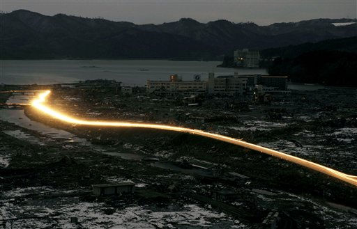 Headlights of vehicles stream along a landscape destroyed in Friday's earthquake and tsunami in Minamisanriku town, Miyagi Prefecture, northeastern Japan, March 17, 2011. (AP Photo/Kyodo News) JAPAN OUT, MANDATORY CREDIT, NO LICENSING IN CHINA, HONG KONG, JAPAN, SOUTH KOREA AND FRANCE