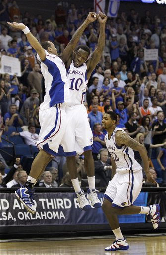 Kansas&#39; Travis Releford, left, Tyshawn Taylor &#40;10&#41; and Marcus Morris, right, celebrate after a Kansas basket during the second half of a Southwest Regional NCAA tournament third-round college basketball game against Illinois on Sunday, March 20, 2011, in Tulsa, Okla. Kansas won the game 73-59. &#40;AP Photo&#47;Charlie Riedel&#41; <span class=meta>(AP Photo&#47; Charlie Riedel)</span>