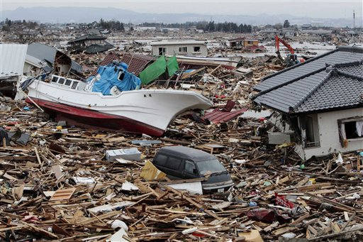 A fishing boat sits amongst debris of houses and cars in Natori, Miyagi Prefecture, Japan, Monday, March 21, 2011, following the March 11 earthquake and tsunami that devastated the northeast coast of Japan. &#40;AP Photo&#47;Mark Baker&#41; <span class=meta>(AP Photo&#47; Mark Baker)</span>