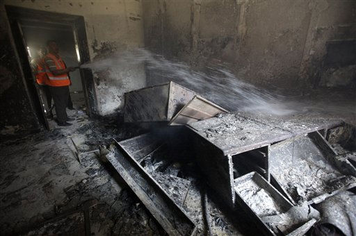 "<div class=""meta ""><span class=""caption-text "">A Syrian municipality worker extinguishes a burned court room that was set on fire by Syrian anti-government protesters, in the southern city of Daraa, Syria, Monday March 21, 2011. Mourners chanting ""No more fear!"" have marched through a Syrian city where anti-government protesters had deadly confrontations with security forces in recent days. The violence in Daraa, a city of about 300,000 near the border with Jordan, was fast becoming a major challenge for President Bashar Assad, who tried to contain the situation by freeing detainees and promising to fire officials responsible for the violence. (AP Photo/Hussein Malla) (AP Photo/ Hussein Malla)</span></div>"