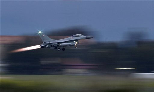 "<div class=""meta ""><span class=""caption-text "">A Danish F-16 takes off from the Nato airbase in Sigonella, Italy, Monday, March 21, 2011. The European Union's top foreign policy official brushed aside concerns Monday that the coalition supporting military action against Libyan leader Col. Moammar Gadhafi is already starting to fracture, saying the head of the Arab League was misquoted as criticizing the operation. (AP Photo/Andrew Medichini) (AP Photo/ Andrew Medichini)</span></div>"
