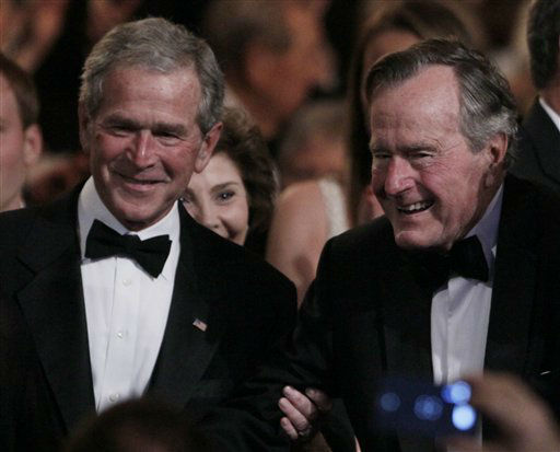 "<div class=""meta ""><span class=""caption-text "">Former President George H. W. Bush, right, is helped by his son former President George W. Bush, left, to his seat at the Kennedy Center, Monday, March 21, 2011, before the ""All Together Now - A Celebration of Service"" performance in honor of former President George H. W. Bush.  (AP Photo/Carolyn Kaster) (AP Photo/ Carolyn Kaster)</span></div>"