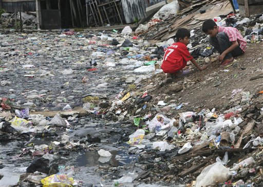 "<div class=""meta image-caption""><div class=""origin-logo origin-image ""><span></span></div><span class=""caption-text"">Indonesian children play near a heavily polluted river in Jakarta, Indonesia, Tuesday, March 22, 2011. March 22 is adopted by the United Nations as World Water Day to raise awareness of freshwater and advocate for the sustainable management of freshwater resources around the world. (AP Photo/Tatan Syuflana) (AP Photo/ Tatan Syuflana)</span></div>"