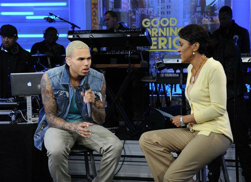 "<div class=""meta image-caption""><div class=""origin-logo origin-image ""><span></span></div><span class=""caption-text"">In this publicity image released by ABC, singer Chris Brown, left, is interviewed by co-host Robin Roberts on the morning program ""Good Morning America,"" Tuesday, March 22, 2011 in New York. Brown was on ?GMA? Tuesday to promote his new album, ?F.A.M.E.,? released the same day. During his interview with Roberts, she asked him about the 2009 attack on his then-girlfriend.  (AP Photo/ABC, Ida Mae Astute) (AP Photo/ Ida Mae Astute)</span></div>"