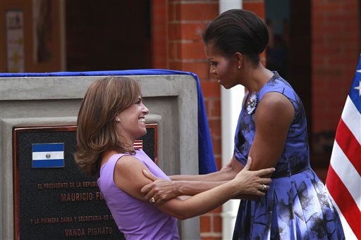 First lady of El Salvador Vanda Pignato, left, and first lady Michelle Obama, right, embrace during the inauguration of the Ciudad Mujer women&#39;s center in San Salvador, El Salvador Tuesday March 22, 2011. President Barack Obama, along with wife, and their two daughters, arrived in the capital of San Salvador on Tuesday afternoon following stops in Brazil and Chile.  &#40;Photo&#47;Dario Lopez-Mills&#41; <span class=meta>(AP Photo&#47; Dario Lopez-Mills)</span>