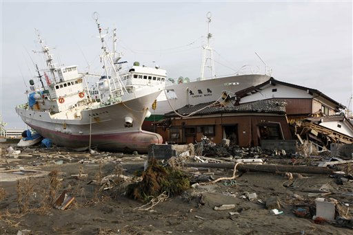 A fishing boat is left agrounded on a wharf at the port in Higashimatsushima City, Miyagi Prefecture, Japan, Tuesday, March 22, 2011 following the March 11 earthquake and tsunami that devastated the northeast coast of Japan.  &#40;AP Photo&#47;Mark Baker&#41; <span class=meta>(AP Photo&#47; Mark Baker)</span>