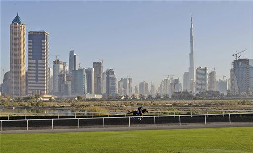 "<div class=""meta image-caption""><div class=""origin-logo origin-image ""><span></span></div><span class=""caption-text"">A racehorse trains during a morning session, three days ahead of the Dubai World Cup, the world's richest horse race, at the Godolphin Club in Dubai, United Arab Emirates, Wednesday March 23, 2011. (AP Photo/Kamran Jebreili) (AP Photo/ Kamran Jebreili)</span></div>"
