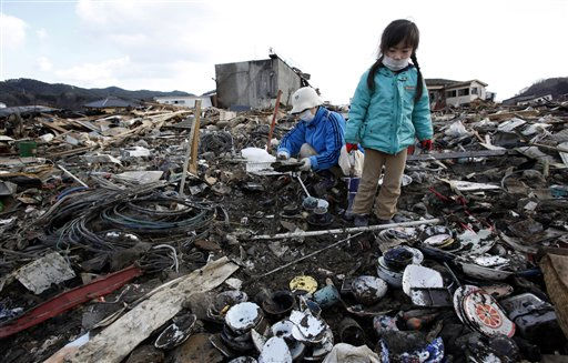 Tokiko Takada, left, and her granddaughter Mai search through the rubble of their home destroyed by the March 11 tsunami at Kesennuma, Miyagi Prefecture, northern Japan, Wednesday, March 23, 2011.  &#40;AP Photo&#47;Shizuo Kambayashi&#41; <span class=meta>(AP Photo&#47; Shizuo Kambayashi)</span>