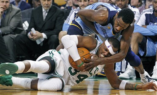 Boston Celtics forward Paul Pierce &#40;34&#41; fights for the ball but Memphis Grizzlies guard Tony Allen &#40;9&#41; ties him up in the second half of an NBA basketball game in Boston on Wednesday, March 23, 2011. The Grizzlies won 90-87. &#40;AP Photo&#47;Elise Amendola&#41; <span class=meta>(AP Photo&#47; Elise Amendola)</span>
