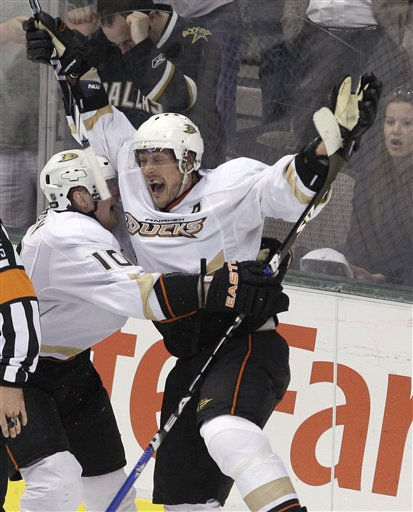 Anaheim Ducks right wing Teemu Selanne, right, of Finland, celebrates with Corey Perry &#40;10&#41; after Selanne scored a goal against the Dallas Stars with seconds left in the third period of an NHL hockey game in Dallas, Wednesday, March 23, 2011. The Ducks won 4-3 in overtime. &#40;AP Photo&#47;LM Otero&#41; <span class=meta>(AP Photo&#47; LM Otero)</span>