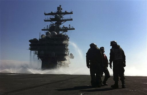 "<div class=""meta ""><span class=""caption-text "">U.S. Navy deck crew stand near the island on the deck which is sprayed for radioactive decontamination aboard USS Ronald Reagan (CVN76) in the Pacific Ocean off the Japanese coast, Wednesday, March 23, 2011. The carrier is off the Pacific coast of Japan to supply relief supplies to the people suffered from the March 11 earthquake and tsunami. (AP Photo/Eugene Hoshiko) (AP Photo/ Eugene Hoshiko)</span></div>"