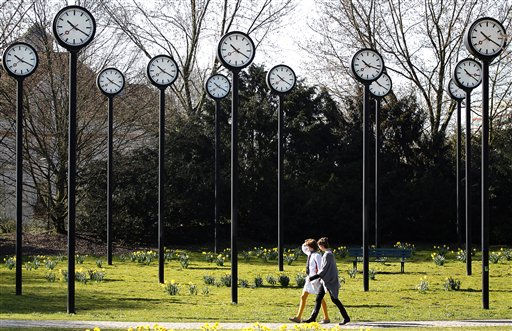 Pedestrians walk during sunny weather in front of clocks at a park in Duesseldorf, Germany, Thursday, March 24, 2011. Most Europeans will have to reset their clocks on Sunday to daylight saving time. &#40;AP Photo&#47;Frank Augstein&#41; <span class=meta>(AP Photo&#47; Frank Augstein)</span>