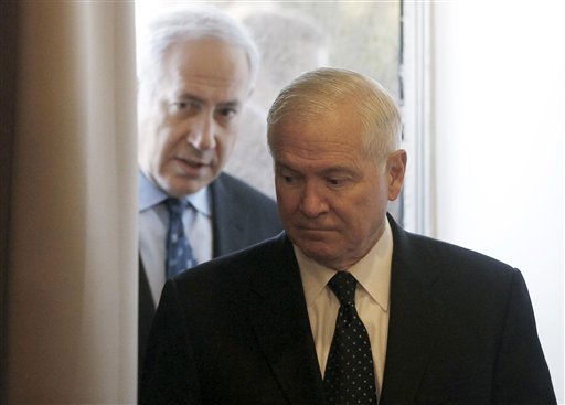 U.S. Defense Secretary Robert Gates and Israel&#39;s Prime Minister Benjamin Netanyahu arrive for their meeting in Caesarea, Israel, Friday, March 25, 2011. &#40;AP Photo&#47;Charles Dharapak, Pool&#41; <span class=meta>(AP Photo&#47; Charles Dharapak)</span>