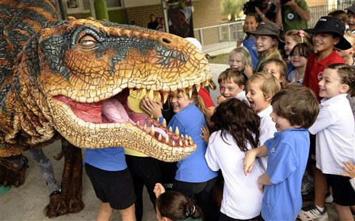 Children at Bondi public school scream as a baby T-rex performs in  Sydney, Australia, Friday, April 1, 2011. The baby T-rex, one of the stars of Walking with Dinosaurs is traveling around the country to visit schools ahead of the new show scheduled to kick off in Melbourne on May 4, 2011. &#40;AP Photo&#47;Rob Griffith&#41; <span class=meta>(AP Photo&#47; Rob Griffith)</span>