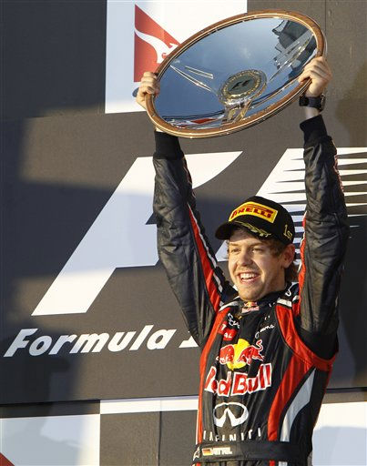 Red Bull Formula One driver Sebastian Vettel of Germany raises his trophy on the podium after winning the Australian Grand Prix at the Albert Park circuit in Melbourne, Australia, Sunday, March 27, 2011. &#40;AP Photo&#47;Vincent Thian&#41; <span class=meta>(AP Photo&#47; Vincent Thian)</span>