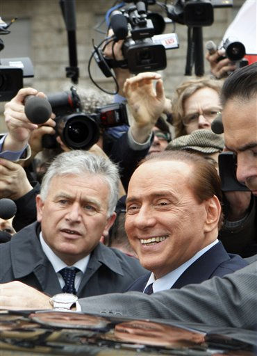 Italian Premier Silvio Berlusconi reacts as he leaves the tribunal in Milan, Italy, Monday, March 28, 2011. Italian Premier Silvio Berlusconi made a rare appearance Monday at a court hearing in Milan for a tax fraud case that he dismissed as groundless and ridiculous. Berlusconi waved to a crowd of reporters and supporters from inside a black sedan as he entered the courthouse for the closed-door hearing. Prosecutors allege fraud in the sale of film rights by his Mediaset company. The Italian leader has a history of legal woes but has rarely showed up in court. He has always denied wrongdoing and denounced what he says are left-leaning magistrates intent on hurting him politically. &#40;AP Photo&#47;Antonio Calanni&#41; <span class=meta>(AP Photo&#47; Antonio Calanni)</span>