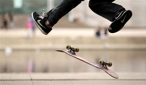 A young man splays his legs as his skateboard flips through the air as he does tricks in Hyde Park in Sydney, Monday, March 28, 2011. &#40;AP Photo&#47;Rick Rycroft&#41; <span class=meta>(AP Photo&#47; Rick Rycroft)</span>