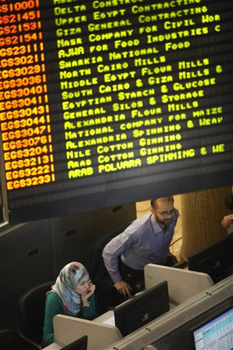 Traders sit under a screen at Egypt&#39;s stock exchange after a nearly two-month closure, in Cairo, Egypt Tuesday, March 29, 2011. Egypt&#39;s benchmark stock index is recording moderate gains for the third consecutive session, with institutional investors seen as particularly active. &#40;AP Photo&#47;Amr Nabil&#41; <span class=meta>(AP Photo&#47; Amr Nabil)</span>