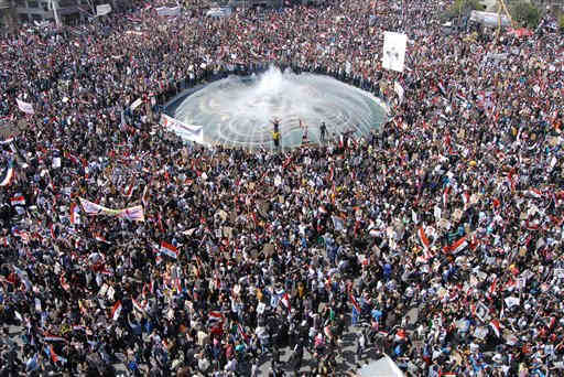 "<div class=""meta ""><span class=""caption-text "">Pro-Syrian President Bashar Assad supporters gather to demonstrate their support for their president, in Damascus, Syria, on Tuesday March 29, 2011. Pledging allegiance for President Bashar Assad as he faces the biggest challenge to his 11-year rule, hundreds of thousands of Syrians gathered in a central Damascus square Tuesday, waving his pictures and chanting support. (AP Photo/Muzaffar Salman) (AP Photo/ Muzaffar Salman)</span></div>"
