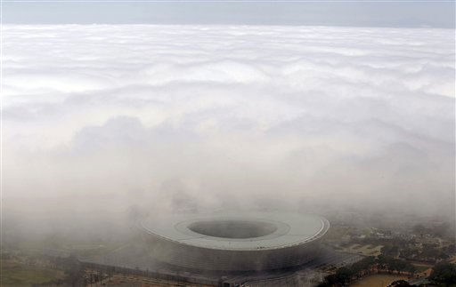 "<div class=""meta ""><span class=""caption-text "">The Cape Town stadium that was used during the 2010 Soccer World Cup is covered with mist in the city of  Cape Town, South Africa, Tuesday, March 29, 2011. Some 50 percent of international tourists arriving in South Africa visit the Western Cape province. (AP Photo/Schalk van Zuydam) (AP Photo/ Schalk van Zuydam)</span></div>"