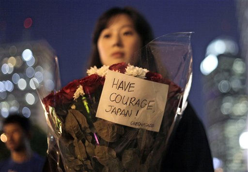 A Greenpeace antinuclear activist holds a flower bouquet during a candlelight vigil for earthquake and tsunami-affected people in Japan, outside the Japanese Embassy in Jakarta, Indonesia, Tuesday, March 29, 2011. &#40;AP Photo&#47;Dita Alangkara&#41; <span class=meta>(AP Photo&#47; Dita Alangkara)</span>