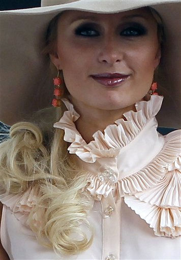 "<div class=""meta ""><span class=""caption-text "">Paris Hilton promotes her new line of shoes at a press conference in Mexico City, Tuesday March 29, 2011.  (AP Photo/Eduardo Verdugo) (AP Photo/ Eduardo Verdugo)</span></div>"