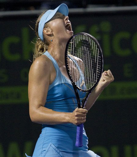 "<div class=""meta image-caption""><div class=""origin-logo origin-image ""><span></span></div><span class=""caption-text"">Maria Sharapova celebrates winning the second set, forcing her match against Alexandra Dulgheru into a third set at the Sony Ericsson Open tennis tournament in Key Biscayne, Fla., Tuesday, March 29, 2011. (AP Photo/J Pat Carter) (AP Photo/ J Pat Carter)</span></div>"