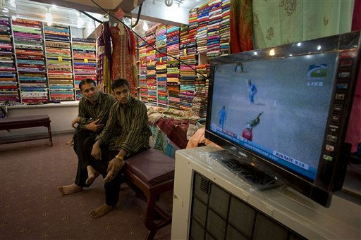 Pakistanis watch the ICC World Cup cricket semifinal match between India and Pakistan on a television set at a clothes shop in Islamabad, Pakistan on Wednesday, March 30, 2011. &#40;AP Photo&#47;Anjum Naveed&#41; <span class=meta>(AP Photo&#47; Anjum Naveed)</span>