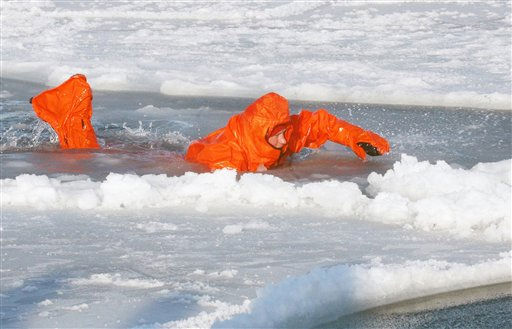 "<div class=""meta ""><span class=""caption-text "">Britain's Prince Harry tries out an immersion suit, during training for the Walking with the Wounded expedition, on the island of Spitsbergen, situated between the Norwegian mainland and the North Pole, Wednesday March 30, 2011. The third in line to the British throne will train for three days before accompanying the team on the first five days of their four-week expedition. (AP Photo/ David Cheskin, Pool) (AP Photo/ David Cheskin)</span></div>"