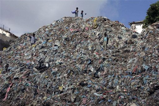 Impoverished Somali children sift through a mountain of garbage in Mogadishu&#39;s southern Hamarjajab neighborhood, Somalia, Wednesday March 30, 2011. Hundreds of children most of them from the displaced families in Mogadishu go out every day roaming the streets and begging  in order to help sustain their families. &#40;AP Photo&#47;Farah Abdi Warsameh&#41; <span class=meta>(AP Photo&#47; Farah Abdi Warsameh)</span>
