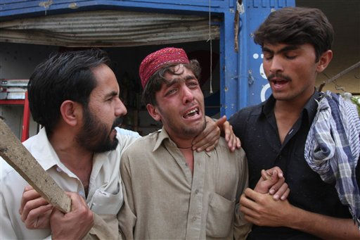 "<div class=""meta ""><span class=""caption-text "">People comfort a man who mourns the death of his family member killed by a roadside bombing in Charsadda near Peshawar, Pakistan on Thursday, March 31, 2011. A suicide bomber struck a convoy carrying a prominent hardline Islamist leader in northwestern Pakistan on Thursday, killing 12 people in what was the second attack that targeted the politician in as many days, police said. (AP Photo/Mohammad Sajjad) (AP Photo/ Mohammad Sajjad)</span></div>"
