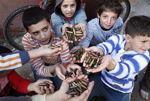 Palestinian children show bullet casings they gathered after early morning clashes in the Palestinian refugee camp of Ein el-Hilweh near the southern port city of Sidon, Lebanon, Thursday, March 31, 2011.  Lebanese and Palestinian officials say clashes between members of Palestinian President Mahmoud Abbas&#39;s Fatah group and hardline Muslim militants led by cleric Osama Chehabi occurred in Ein el-Hilweh Thursday and have wounded five people in Lebanon&#39;s largest refugee camp. &#40;AP Photo&#47;Mohammed Zaatari&#41; <span class=meta>(AP Photo&#47; Mohammed Zaatari)</span>