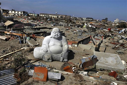 A statue of Hotei Buddha sits in the debris in the  tsunami-destroyed town of Sendai, Miyagi Prefecture, northern Japan Friday, April 1, 2011. &#40;AP Photo&#47;Vincent Yu&#41; <span class=meta>(AP Photo&#47; Vincent Yu)</span>