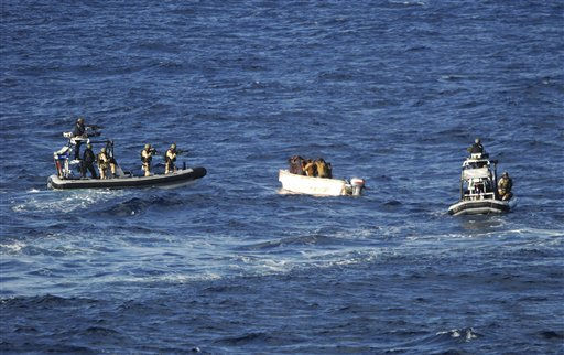 In this photo taken Sunday, April 3, 2011 and released by Dutch defense ministry Monday April 4, 2011, armed Dutch marines on board of two Dutch navy motorboats capture suspected pirates in a small skiff off the coast of Somalia in an operation to free it from pirates. The Dutch defense ministry says its marines have killed two pirates and captured 16. &#40;AP Photo&#47; Dutch Defense Ministry&#47;HO&#41; <span class=meta>(AP Photo&#47; Anonymous)</span>