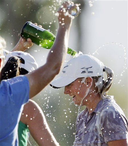 Friends and family shower Stacy Lewis with champagne and beer after she won the LPGA Kraft Nabisco championship golf tournament at Mission Hills Country Club in Rancho Mirage, Calif., Sunday, April 3, 2011. &#40;AP Photo&#47;Reed Saxon&#41; <span class=meta>(AP Photo&#47; Reed Saxon)</span>