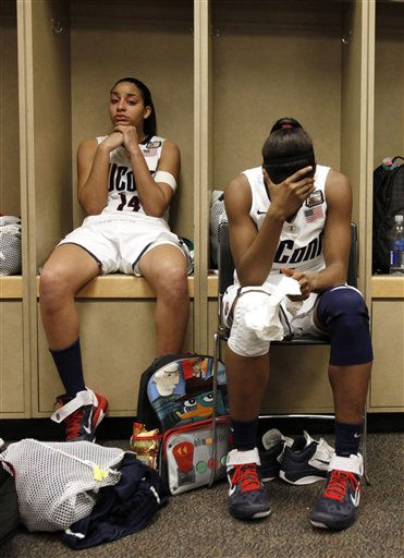 "<div class=""meta ""><span class=""caption-text "">Connecticut's Bria Hartley (14) and Tiffany Hayes react in the locker room after their 72-63 loss to Notre Dame in a women's NCAA Final Four semifinal college basketball game in Indianapolis, Monday, April 4, 2011.  (AP Photo/Amy Sancetta) (AP Photo/ Amy Sancetta)</span></div>"