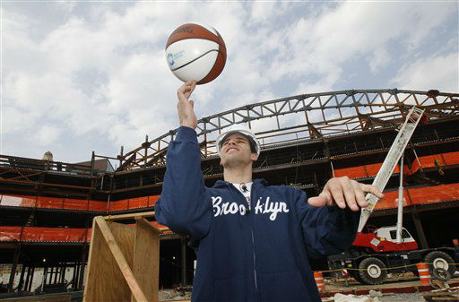 New Jersey Nets forward Kris Humphries pose for a photograph as he tours of the site of the Barclays Center, under construction near downtown Brooklyn in New York, Monday, April 4, 2011.  The Barclays Center is scheduled to become the Nets home arena in 2012.  &#40;AP Photo&#47;Kathy Willens&#41; <span class=meta>(AP Photo&#47; Kathy Willens)</span>