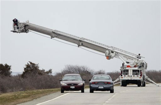"<div class=""meta ""><span class=""caption-text "">A man in a fire department bucket ladder searches in the brush near Oak Beach, N.Y., Monday, April 4, 2011. Three sets of human remains were found Monday bring to eight the total number of bodies found in the area since December. (AP Photo/Seth Wenig) (AP Photo/ Seth Wenig)</span></div>"