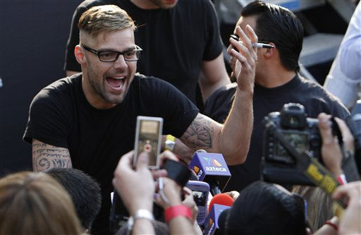 "<div class=""meta ""><span class=""caption-text "">Puerto Rican pop star Ricky Martin gestures while signing autographs in Mexico City, Tuesday, April 5, 2011.  Ricky is presenting his new album  ""Musica+Alma+Sexo"" . (AP Photo/Marco Ugarte) (AP Photo/ Marco Ugarte)</span></div>"